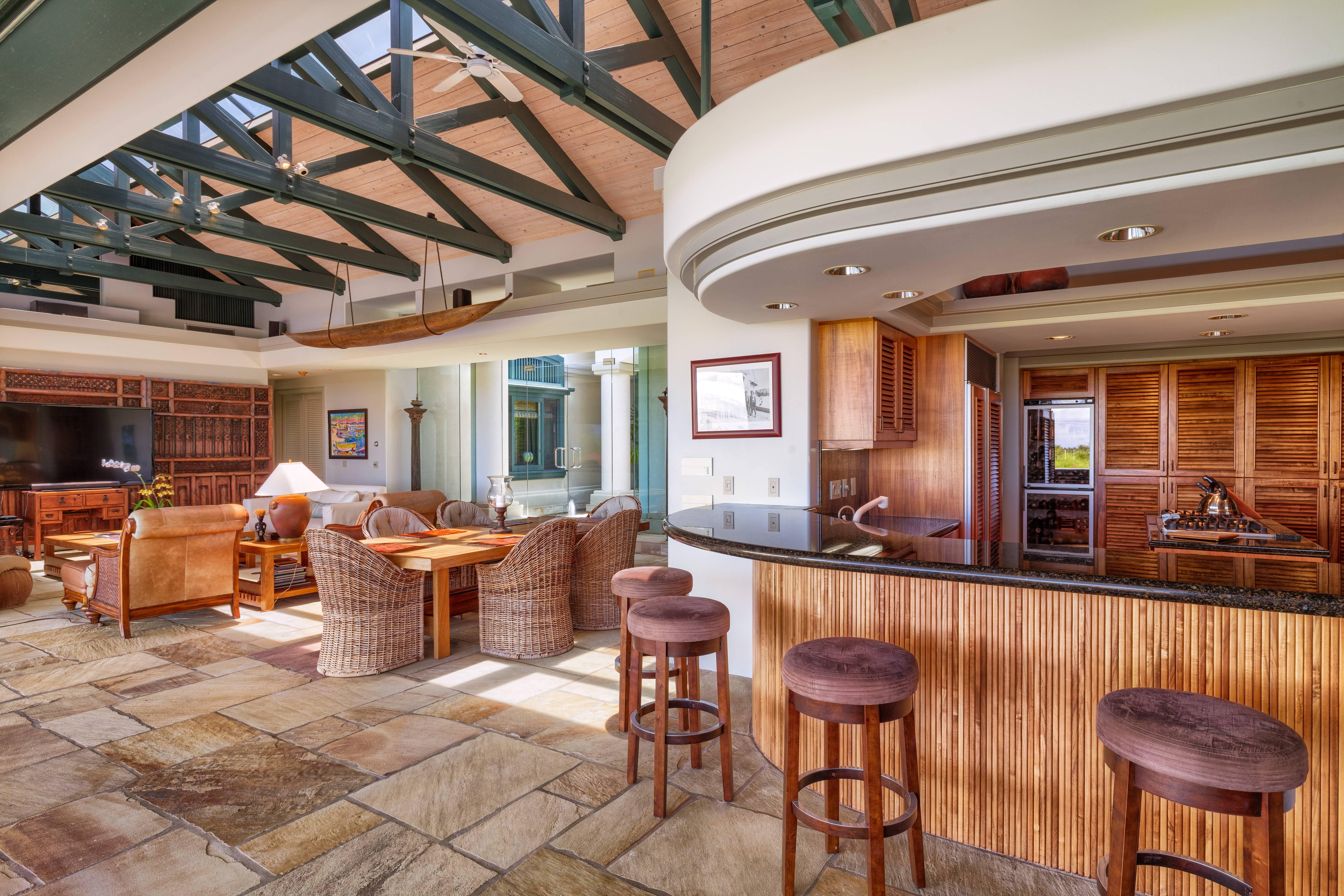 Kitchen and dining room at Champion Ridge Estate 24, Mauna Lani Resort