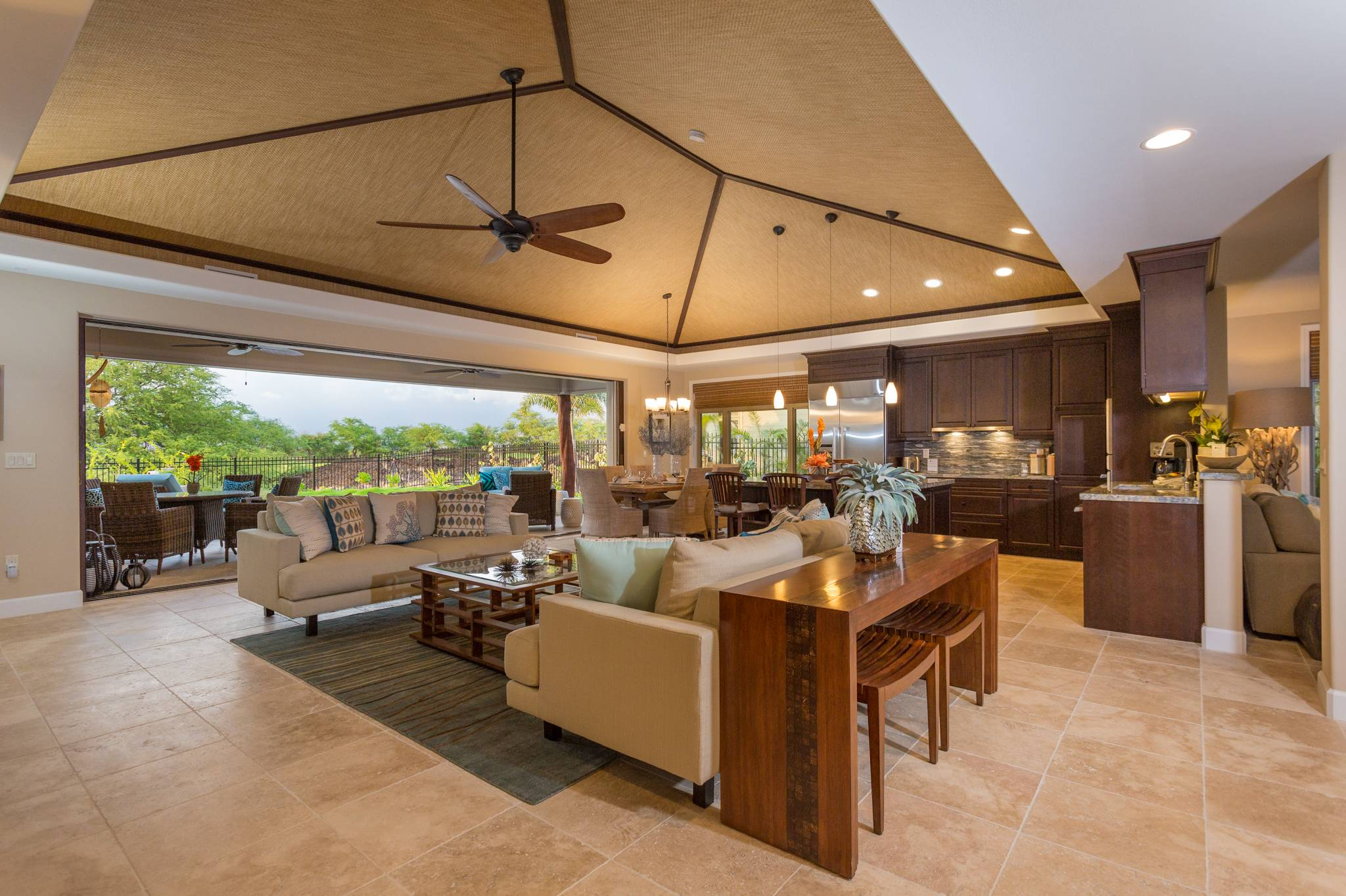 Kitchen and living room at KaMilo private Big Island home