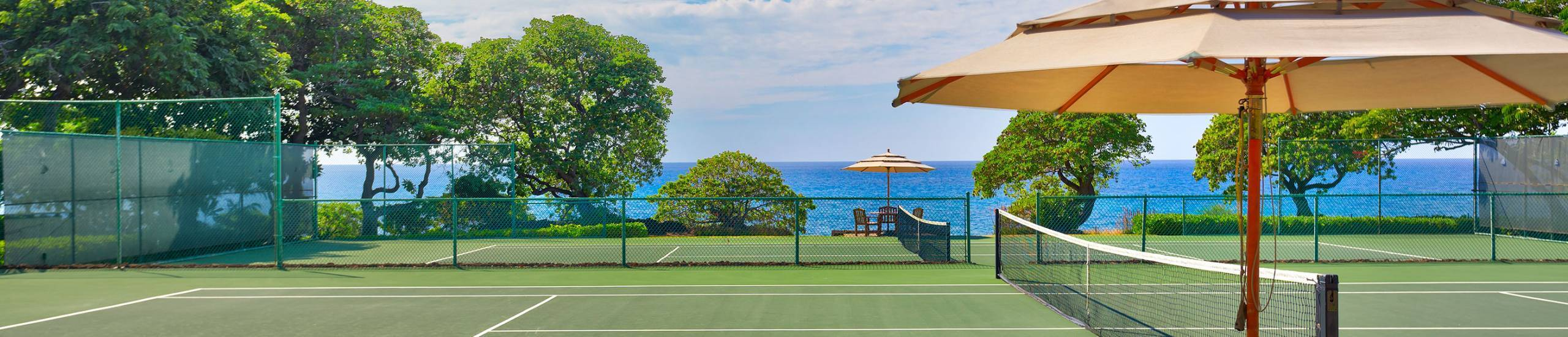 Mauna Kea Resort tennis courts overlooking ocean
